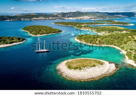 Aerial view of Paklinski Islands in Hvar, Croatia. Turquise water bays with luxury yachts and sailing boats. Toned image. Royalty-Free Stock Photo #1810555702