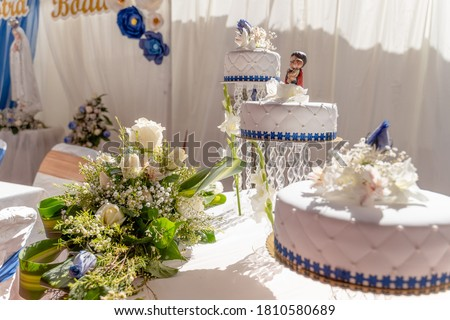 white cake designed for a wedding with a religious image