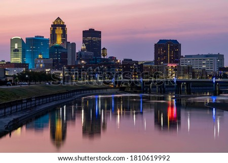 Reclections of the Des Moines Skyline in the Des Moines River at Sunset