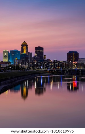 Reflections of Des Moines Skyline in the Des Moines River at Sunset - Vertical Composition