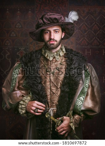 Portrait of a handsome man grandee in 16th century costume. Royalty-Free Stock Photo #1810697872