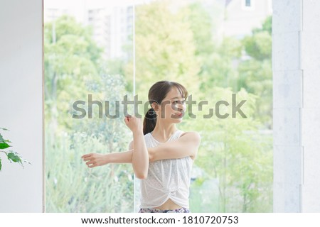 Asian woman exercising at home Royalty-Free Stock Photo #1810720753