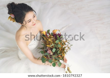 Bridal concept of an asian woman. Royalty-Free Stock Photo #1810792327