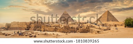 Sphinx and pyramids in the egyptian desert Royalty-Free Stock Photo #1810839265