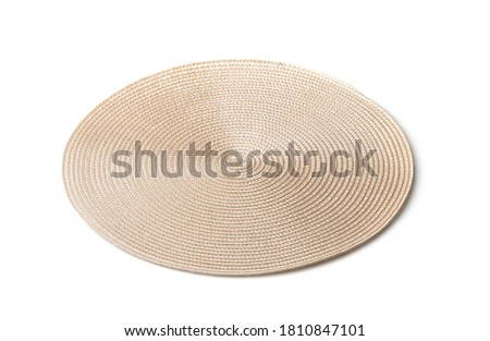 Round braided placemat isolated on white Royalty-Free Stock Photo #1810847101
