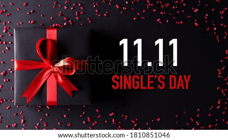 Online shopping of China, 11.11 singles day sale concept. Top view of black christmas boxes with red ribbon on black background with copy space for text 11.11 singles day sale. Royalty-Free Stock Photo #1810851046
