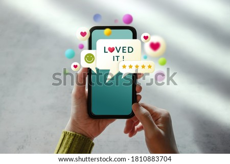 Customer Experiences Concept. Woman Using Mobile Phone to Giving Feedback via the Internet. Positive Review. Client Satisfaction Surveys #1810883704