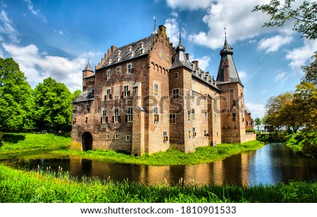 Ancient castle on water landscape Royalty-Free Stock Photo #1810901533