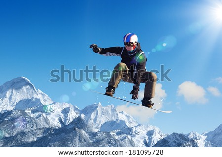 Snowboarder making jump high in clear sky #181095728