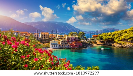 Assos village in Kefalonia, Greece. Turquoise colored bay in Mediterranean sea with beautiful colorful houses in Assos village in Kefalonia, Greece, Ionian island, Cephalonia, Assos village. #1810972297