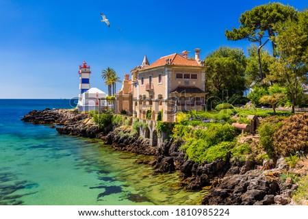 Santa Marta lighthouse and Municipal museum, Cascais, Lisbon, Portugal. Lighthouse Museum of Santa Marta in Cascais Portugal, as seen from Santa Marta Beach on a beautiful day. Cascais, Portugal. #1810985224