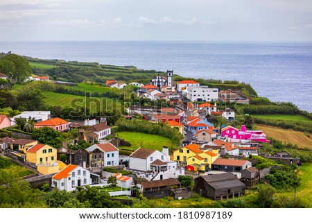 Beautiful nature view on Azores with small villages, tows, green nature fields. Amazing Azores. View of typical Azores village in Sao Miguel island, Azores, Portugal. Royalty-Free Stock Photo #1810987189