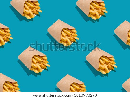 Lots Of French Fries In Paper Boxes Over Blue Background, Geometric Seamless Design, Creative Repeat Pattern, Top View