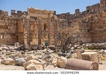 Baalbek temple complex in Lebanon. Massive Roman ruins. Impressive columns and stone walls Royalty-Free Stock Photo #1810998298