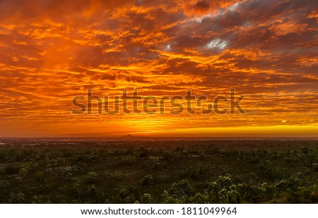 Sunset horizon cloudy sky landscape. Sunset sky clouds over field. Sunset field sky clouds. Sunset sky clouds #1811049964