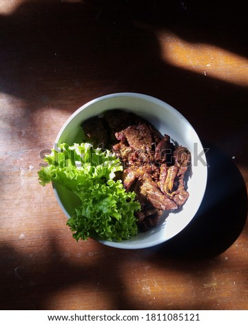 a bowl of beef dish #1811085121