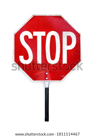 Aged hand-held stop sign or paddle used for traffic control by crossing guards, police or work zones. Red and white metal texture sign in octagon shape and a pole to hold. Isolated on white.