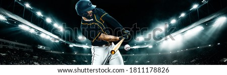Wide photo. Porfessional baseball player with ball on grand arena. Ballplayer on stadium in action. Royalty-Free Stock Photo #1811178826