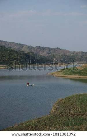 a sight of a fisherman in the middle of a lake #1811381092