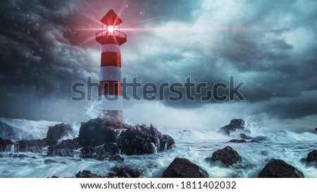 Lighthouse in a stormy sea Royalty-Free Stock Photo #1811402032