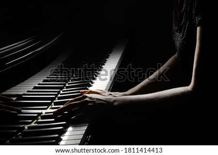 Piano player. Pianist hands playing grand piano keys. Music instrument keyboard