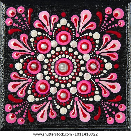 Mandala dot art painting on wood tiles. Beautiful mandala hand painted by colorful dots on black wood. National patterns with acrylic paints, handwork, dot painting. Abstract dotted background. #1811418922