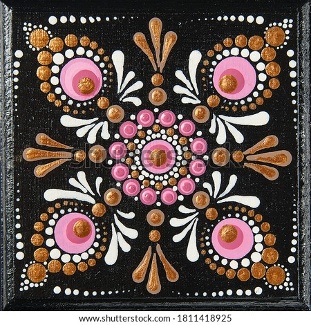 Mandala dot art painting on wood tiles. Beautiful mandala hand painted by colorful dots on black wood. National patterns with acrylic paints, handwork, dot painting. Abstract dotted background. #1811418925