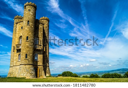Medieval fortress tower in field. High tower fortress. High tower castle. Medieval tower #1811482780