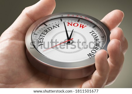 Man hand holding a conceptual clock with the words yesterday, now and tomorrow. Concept of time management or living in the present moment. Composite image between a photography and a 3D background. Royalty-Free Stock Photo #1811501677