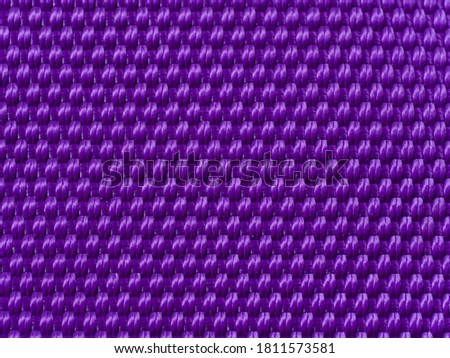 abstract purple fabric texture blur background with closeup surface and fiber of silk for wallpaper and pattern design