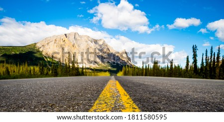 Yellow line on road to mountains. Mountain highway road. Route on mountain road. Mountain asphalt road #1811580595
