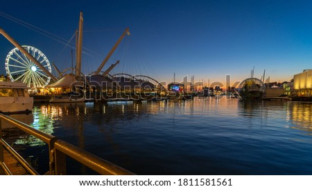 Porto Antico Old Port at sunset in Genoa in Italy. Royalty-Free Stock Photo #1811581561