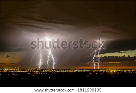 Lightning in the stormy sky over the city. Lightning over night city. Lightning thunderbolt view. Lightnings in night sky