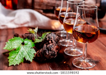 Tasting glasses with aged french cognac brandy in old cellars of cognac-producing regions Champagne or Bois, France Royalty-Free Stock Photo #1811598592