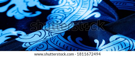 Blue and white monogrammed silk fabric. An exquisite pattern of filigree fabric. texture, background