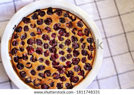 Homemade baked cherry clafoutis. Close-up cherry pie Royalty-Free Stock Photo #1811748331