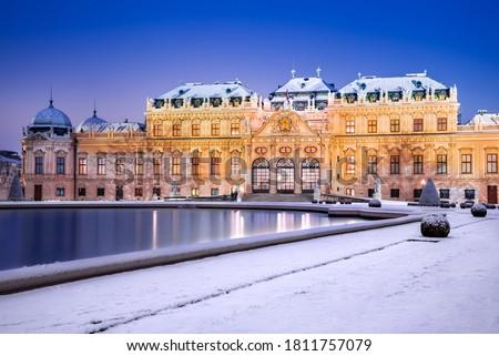 Vienna, Austria. Upper Belvedere snowy winter night reflection, Wien austrian travel background. Royalty-Free Stock Photo #1811757079