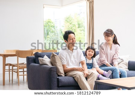 Family talking in the living room #1812124789