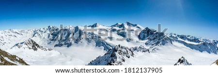 Winter snow mountain peaks panoramic landscape. Snowy winter mountains. Mountain winter snow panorama. Winter snow mountain panorama #1812137905