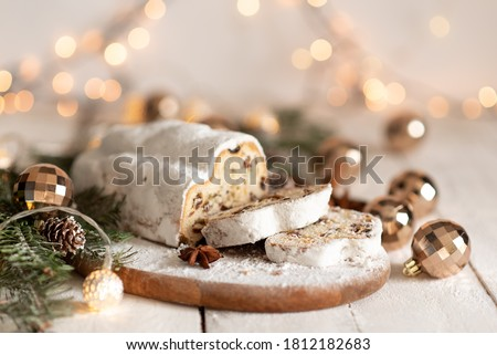 Christmas stollen on wooden background. Traditional Christmas festive pastry dessert. Stollen for Christmas #1812182683