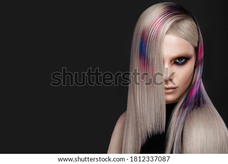 Portrait of beautiful woman with multi-colored hair and creative make up and hairstyle.