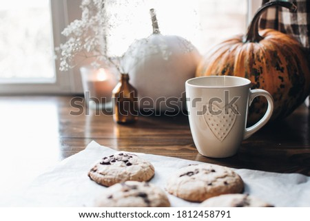 Fall styled composition. Autumn breakfast still life. Scandinavian hygge concept. Morning concept. Breakfast in bed. Cozy autumn homely scene with pumpkins. Flat lay. Home decor.