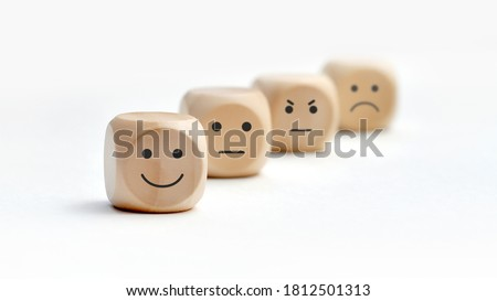 Variety of emotions in life. Joy, calmness, sadness, anger. Choosing a positive Royalty-Free Stock Photo #1812501313