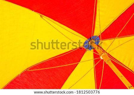 colorful beach umbrella close up #1812503776