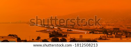 Thick orange haze above San Francisco on September 9 2020 from record wildfires in California, daytime view of ash and smoke floating over the Bay Area #1812508213