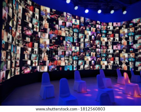 Blurred LED screen of many people faces join big online event or live conference.Work at home.Video online conference.Social distancing in state quarantine.New normal event production.Online meeting #1812560803