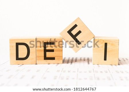 Word defi made with wood building blocks, stock image