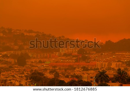 Thick orange haze above San Francisco on September 9 2020 from record wildfires in California, daytime view of ash and smoke floating over the Bay Area #1812676885