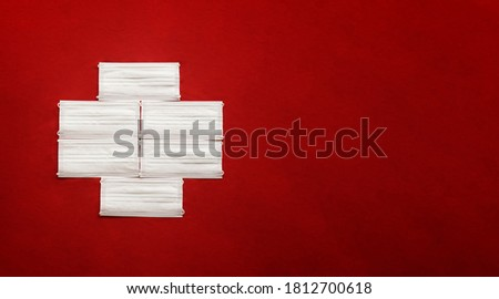 COVID-19 text input banner sign, First aid sign, Medical icon made with white masks on red background. cross flag. Red banner. Face masks to fight against the spread of virus. COVID19