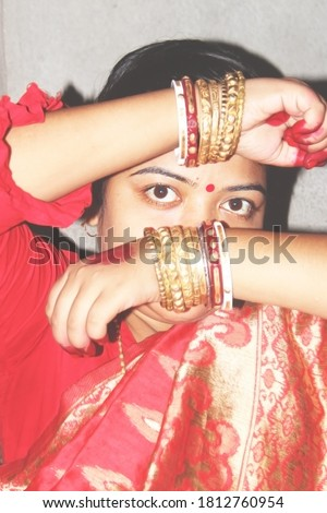 Portrait. Beautiful Bong housewife. Girl With Oriental Accessories - Earrings, Bracelets,bangles,shakha(shankha) pola etc.